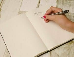 Bild zeigt offenes Notizheft